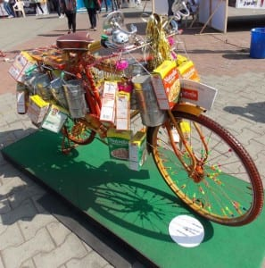 Colourful dabbawala cycle promoting a commercial food product.