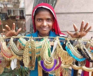 An Indian village girl selling ethnic necklaces at Kala Ghoda Festival.