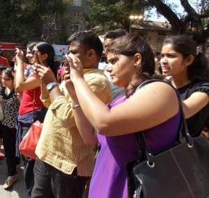 'Capturing art on technology'- Visitors capturing memories of the Kala Ghoda Festival.