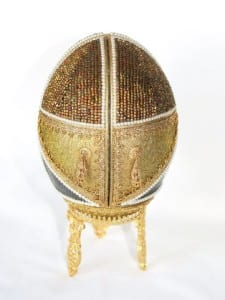 A two-door-cut Hand Decorated Emu Egg by Patricia Newell Dunkley