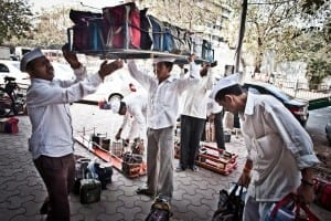Dabbawalas about to sort the tiffins as per their unique coding system. Photo courtesy: Google images.