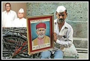 A Dabbawala holding the photograph of Mr. Mahadev Havaji Bachche, the founding father of the dabbawala tiffin supply system. Top corner: President & General Secretary of Nutan Mumbai Tiffin Box Suppliers Charity Trust , Mr. Raghunath Medge (left) & Mr. Gangaram Talekar. Photo edited by Aditya Chichkar.