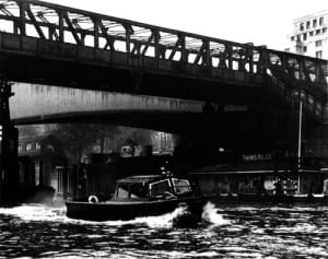 The floating police pier under Waterloo Bridge, complete with police launch.