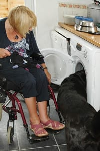 Ann Hanson gets help with the laundry