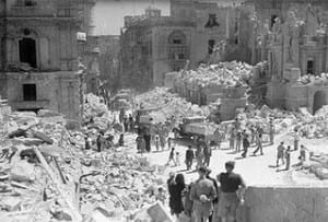 This is Malta's main street Kingsway after intensive bombing which demolished the splendid Opera House (right).