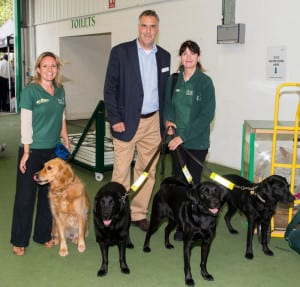 Dogs for the Disabled Chief Executive Peter Goring and some of the team
