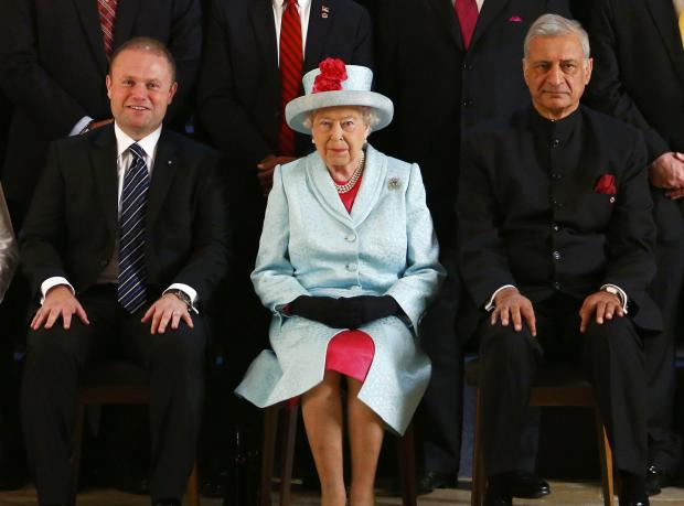 The Queen flanked by Maltese PM Joseph Muscat (left) and the Commonwealth's outgoing Secretary General Kamale Sharma.