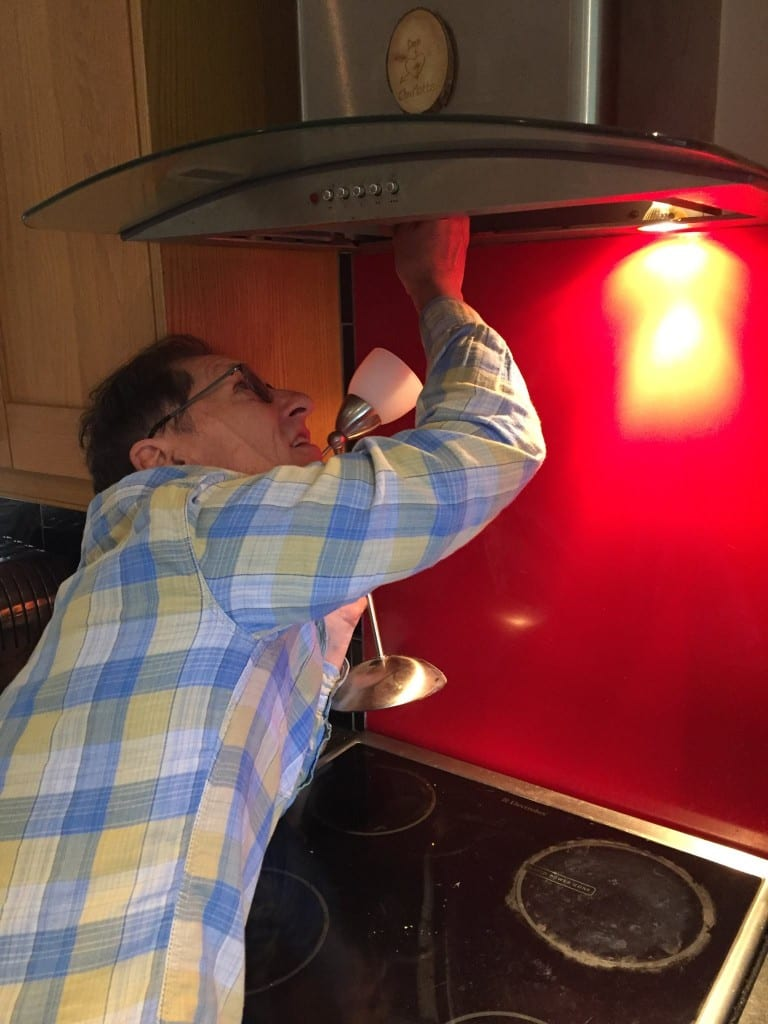 Rescuer Keith helping a trapped sparrow in an kitchen extractor fan