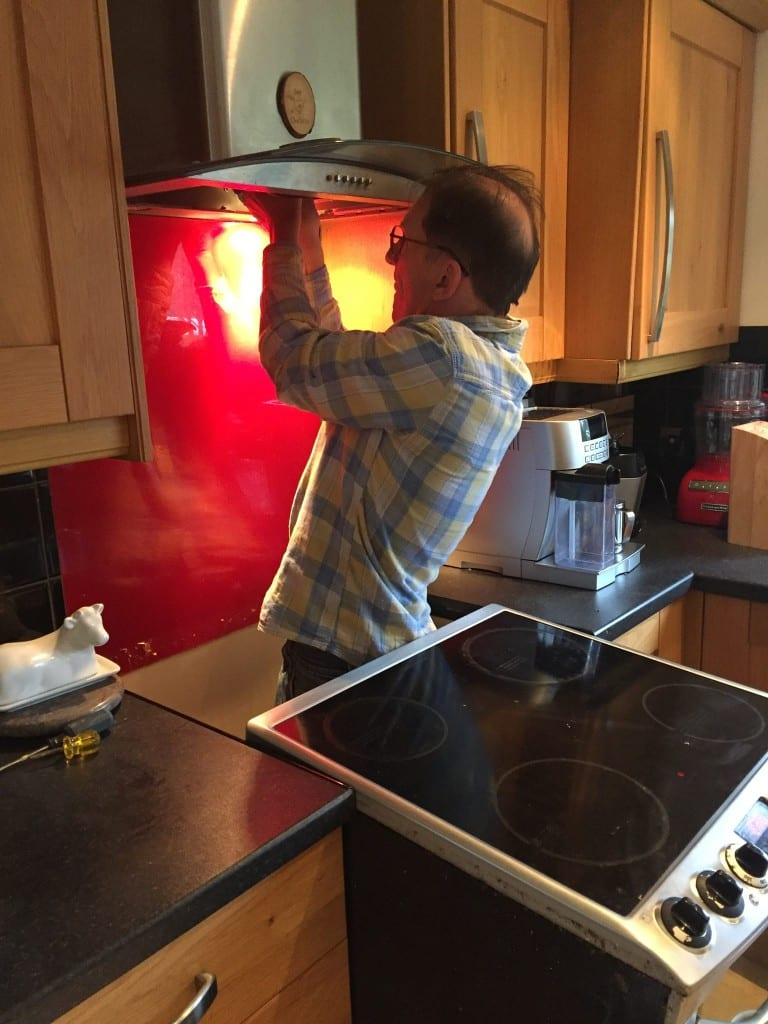 Rescuer Keith helping a trapped sparrow in an kitchen extractor fan (