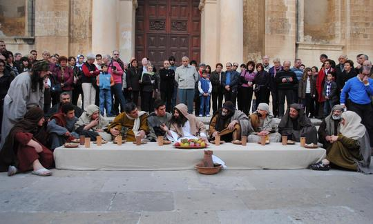 Live enactment of feet washing ritual and Last Supper display at St John's Cathedral, Valletta.