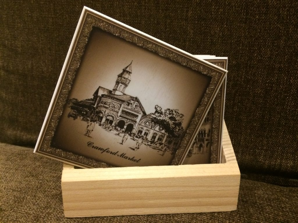 The heritage structure of Crawford Market on tea coasters.