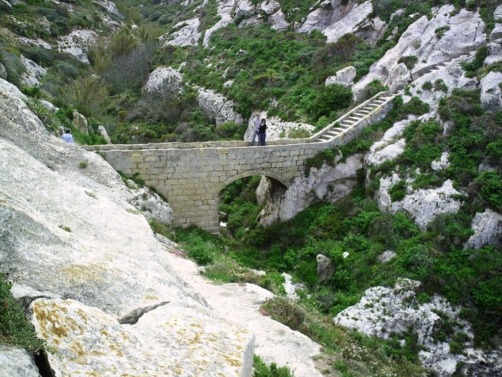 the-small-stone-pedestrian-bridge-linking-xlendi-to-the-surrounding-hills