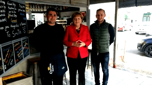 German-Chancellor-Angela-Merkel-meets-the-kiosk-staff-that-served-her-breakfast
