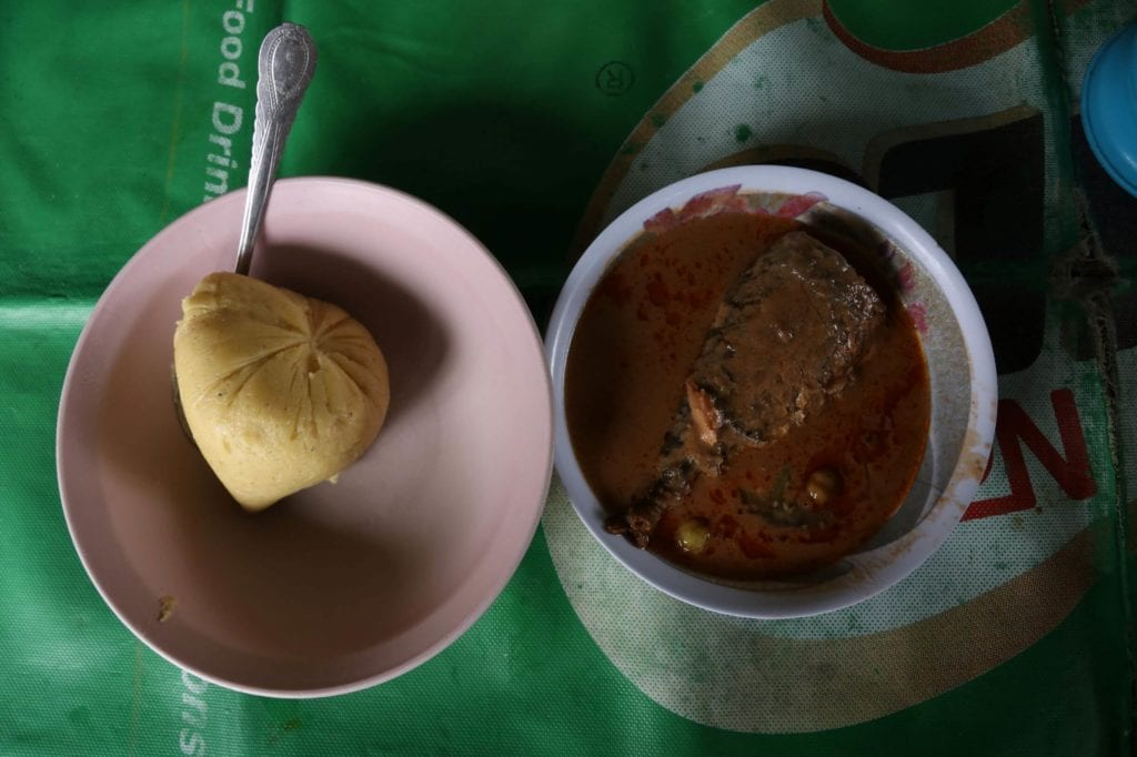 Banku corndough served with fish and groundnut stew