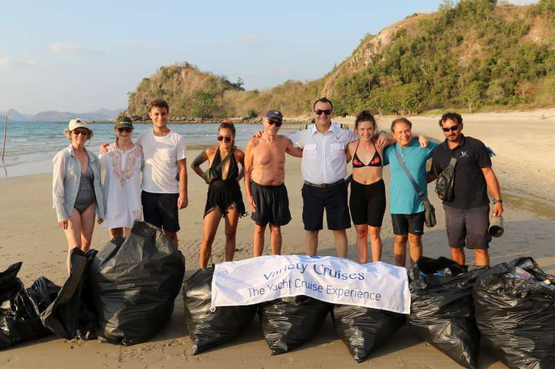Captain Leontios and passengers with their haul of rubbish from one beach on Flores Island