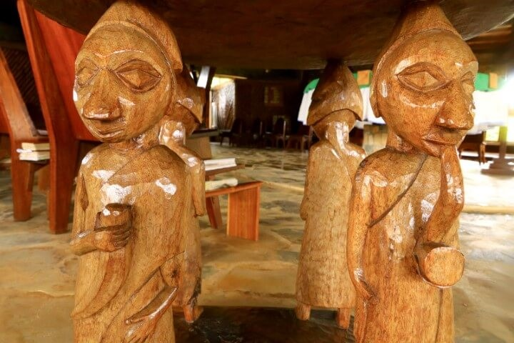 Hand carved figurines that support a table