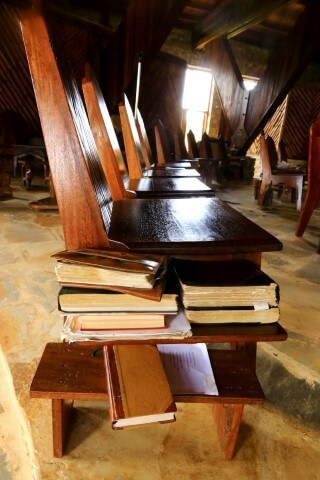 Wooden chairs and bibles Main chapel