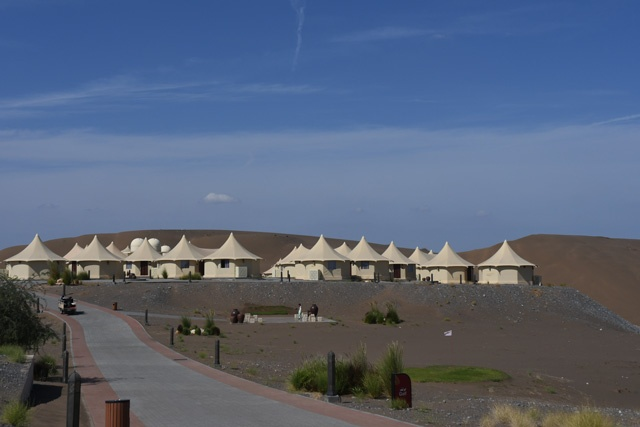 The luxury tents on top of a dune