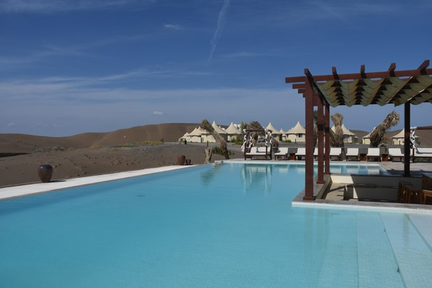 The infinity pool in the middle of a sand desert