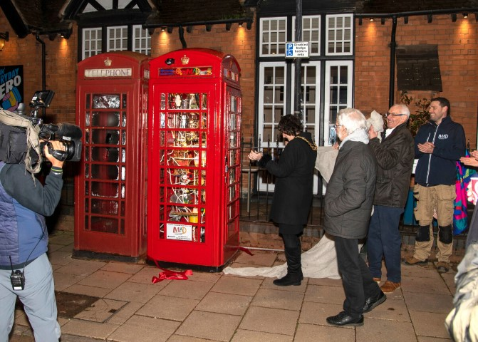 Pic Unveiling the MAD Museums kinetic sculpture in a telephone box with artist Pascal Bettex looking on