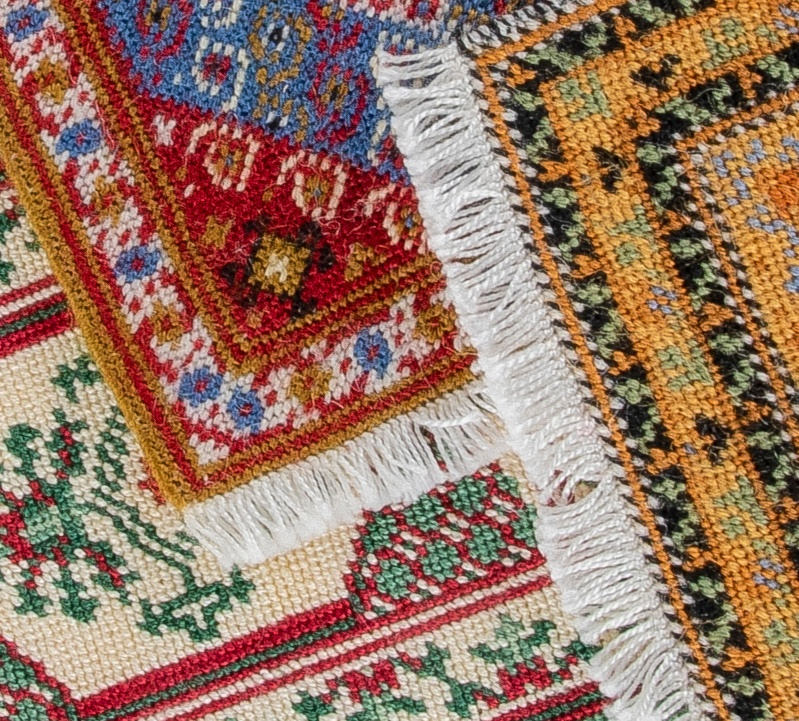Pic Hand stitched rugs by the Miniature Needlework Society
