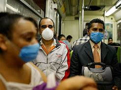 Train travelllers wearing face masks