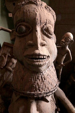 Large wooden statute of wide eyed female