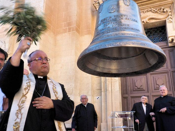 MalDia Malta Archbishop Charles J Scicluna blessing a new bell with olive twigs and leaves