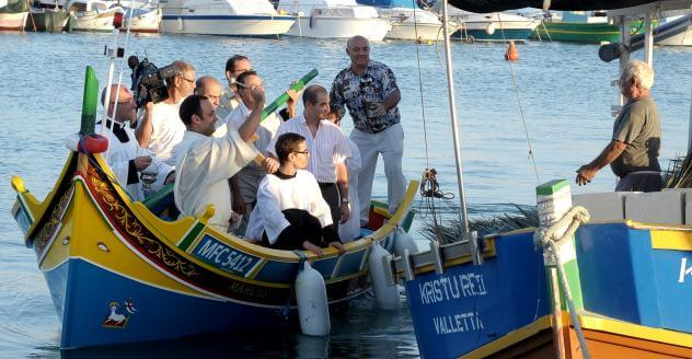 MalDia Marsaxlokks parish priest blesses the fishing fleet before the season starts