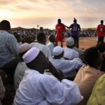 1. Spectators and players at a Nubian wrestling tournament.