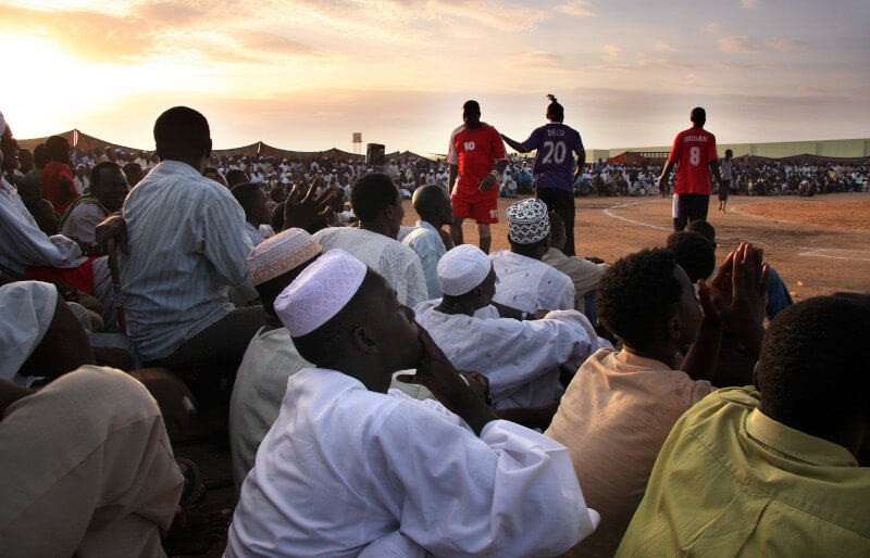 Spectators and players at a Nubian wrestling tournament