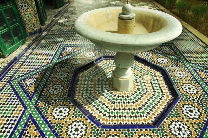 Marble fountain above zeltij tile work in the central courtyard The Bahia Palace