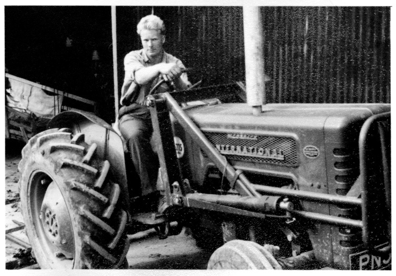 Driving the tractor during his farming years