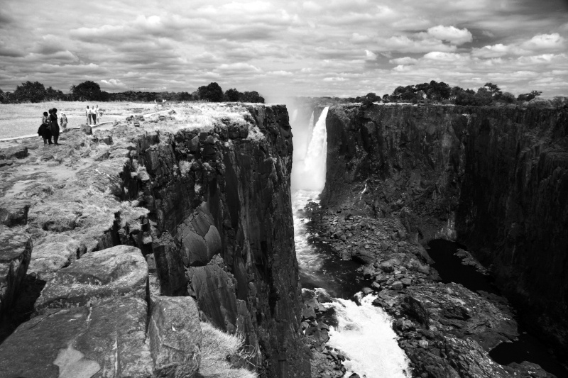 Around the dried up Rainbow Falls with visitors on the falls path Zimbabwe