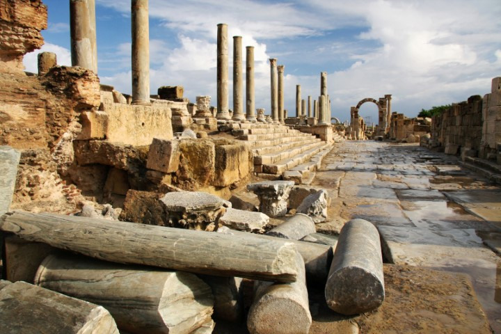 1.-Fallen-marble-pillars-with-the-Arch-of-Tiberius-behind.