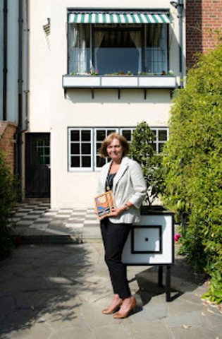 Pic-8.-Christine-Sanderson-with-her-first-Bassett-Lowke-book-at-the-rear-of-78-Derngate.-Pic-by-Rob-Tysall.