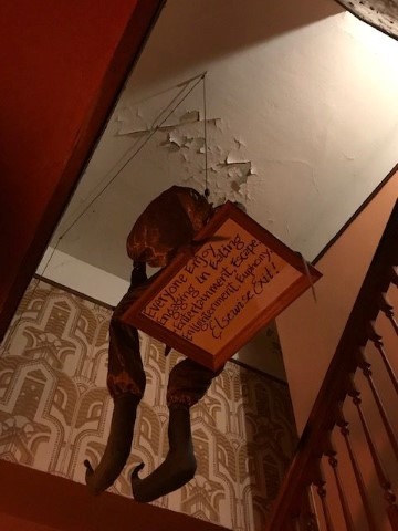 Spooky-Ceiling-Sign-Leading-to-Upstairs-Bathroom