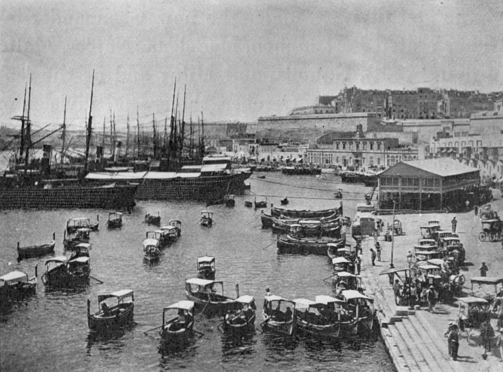 MalDia Vallettas Grand Harbour teeming with dghajsas in the late th Century waiting to taxi sailors back to their ships